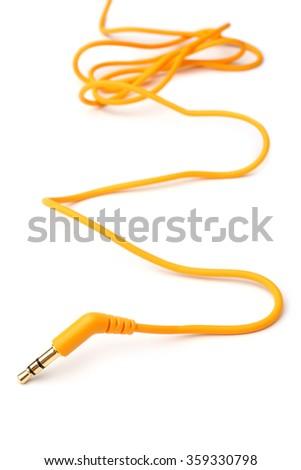 Orange audio cable 3,5mm jack plug on white background - stock photo