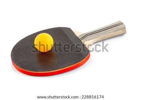 Orange ball lies on top of a black wooden table tennis rackets isolated on white background - stock photo