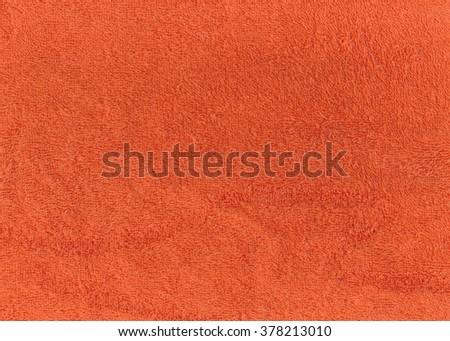 Orange bath xoootn towel texture. Background and texture. - stock photo