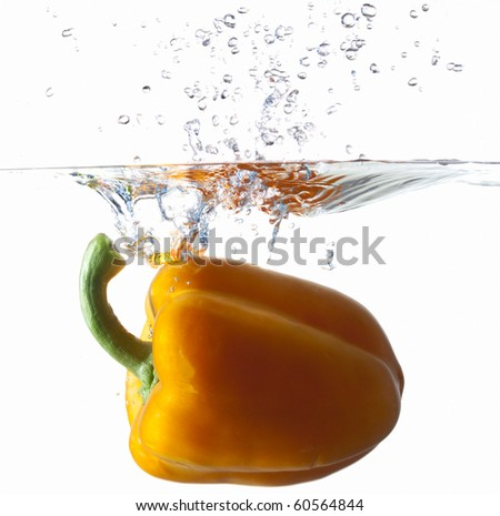 Orange Bell Pepper Dropping Into Water
