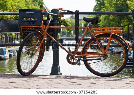 orange bike and the canals of Amsterdam