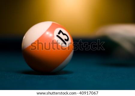 Orange billiard ball on a pool table - stock photo