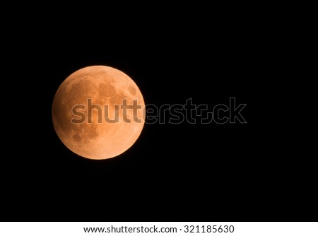 Orange Blood Moon during a Lunar Eclipse - stock photo