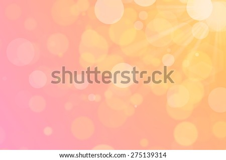 Orange bokeh abstract background with sun flare. - stock photo