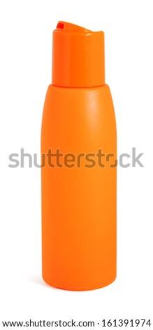 Orange bottle with suntan cream isolated on white background - stock photo