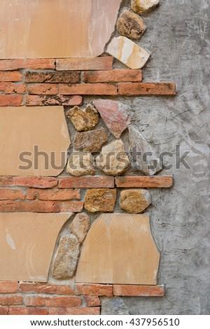 Orange Brick , Stone and Cement wall - stock photo