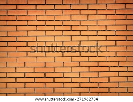 Orange brick wall background - stock photo