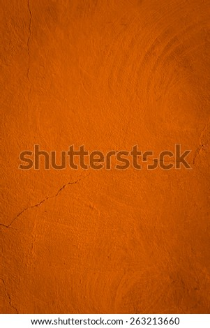 Orange brown background made with a texture of a red  wall - stock photo