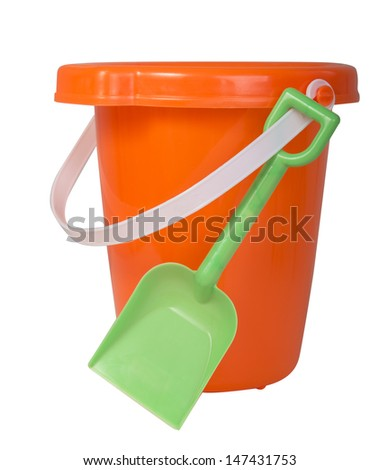 Orange bucket with white handle and green plastic shovel ready for summer fun isolated on white