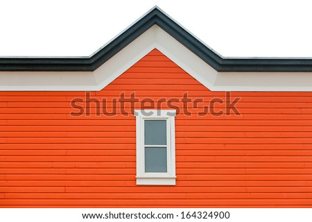 Orange building facade with window and fancy roof trim as architecture background pattern abstract - stock photo