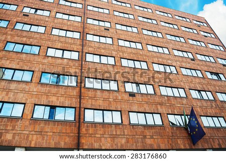 orange building with european flag in Bologna, Italy - stock photo