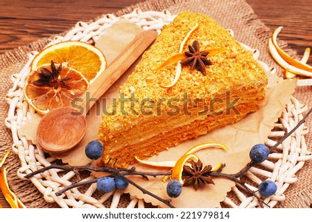 Orange cake on a wooden background - stock photo