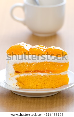 Orange cake with coffee cup