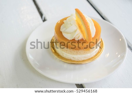 orange cake with orange topping and whipped cream