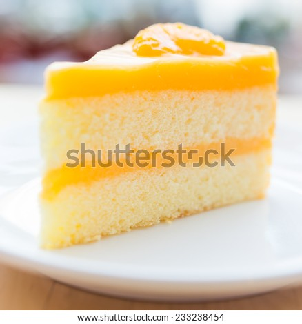 Orange cakes in white plate on wooded table