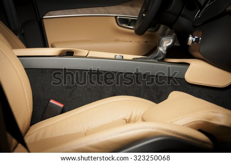 Orange car leather interior texture with stitch - stock photo