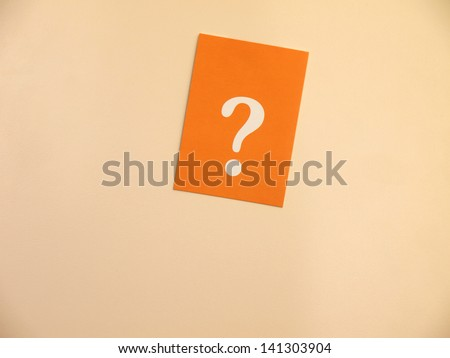 Orange card with a question mark on a bright background - stock photo