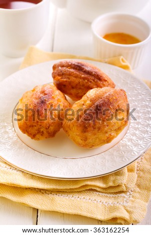 Orange cardamom madeleines cookies in a plate - stock photo