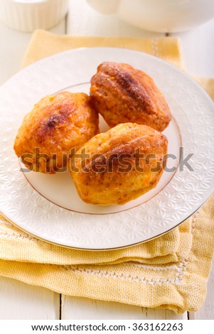 Orange cardamom madeleines cookies in a plate