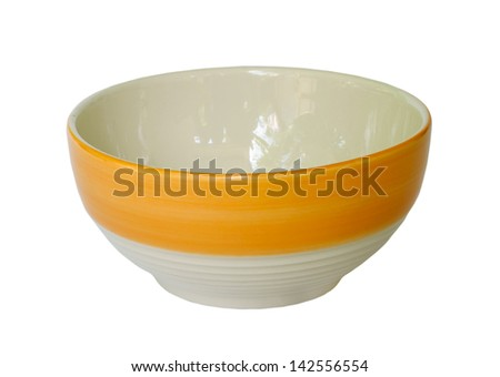Orange ceramic bowl on white background. - stock photo