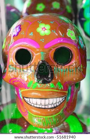 Orange ceramic skull - stock photo
