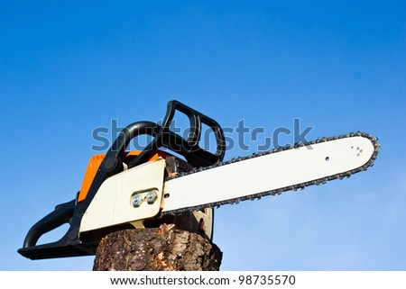 Orange chainsaw with emphasis in blade - stock photo
