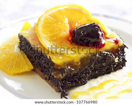 Orange - Chocolate cake on plate. - stock photo