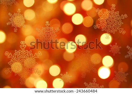 Orange Christmas background blur and snowflakes - stock photo