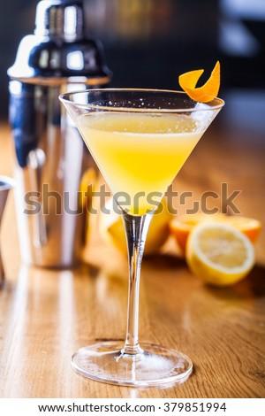 Orange cocktail in martini glass - stock photo