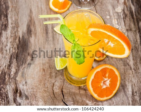 Orange cocktail on wood, top view - stock photo