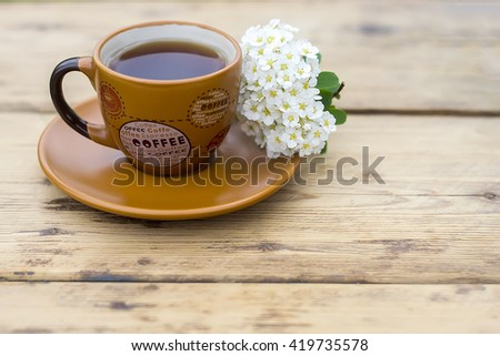 orange coffee Cup on a wooden table - stock photo