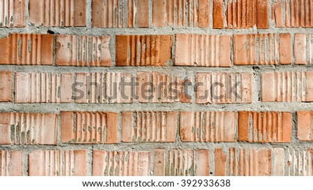 Orange color brick wall surface texture of built house as background imageOrange color brick wall surface texture of built house as background image