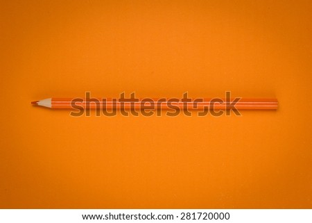 orange color drawing pencil on orange paper - stock photo