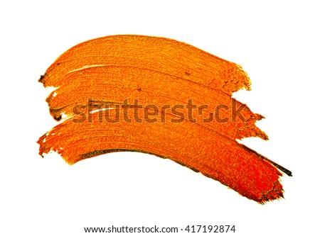 Orange color lipstick stroke on white background - stock photo
