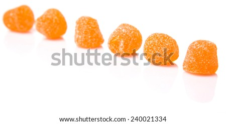 Orange colored sugar jelly candy over white background