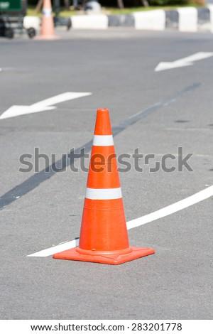 orange cones on street - stock photo