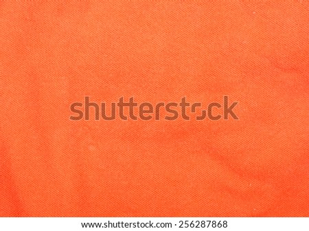 Orange cotton fabric texture background. - stock photo