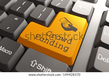 Orange Crowd Funding Button on Computer Keyboard. Internet Concept. - stock photo
