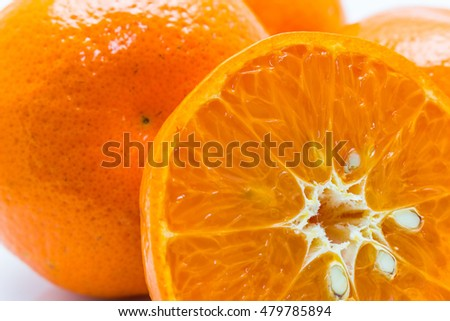 Orange cut in half on white blackground