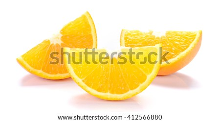 Orange cut pieces isolated on white background.