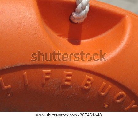 Orange dirty lifebuoy background - stock photo