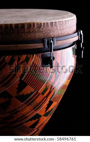 Orange Djembe on Black Background - stock photo