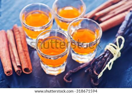orange drink in shot glasses - stock photo