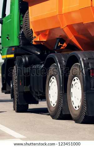 Orange dump truck chassis close to the road - stock photo