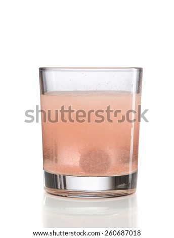 Orange effervescent tablet in a glass of water. Isolate on white. - stock photo