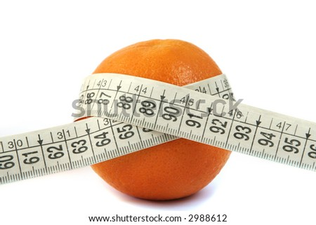Orange embraced by a measuring tape - stock photo