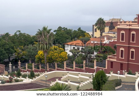 Orange Facade Spanish colonial house located town of Spain - stock photo