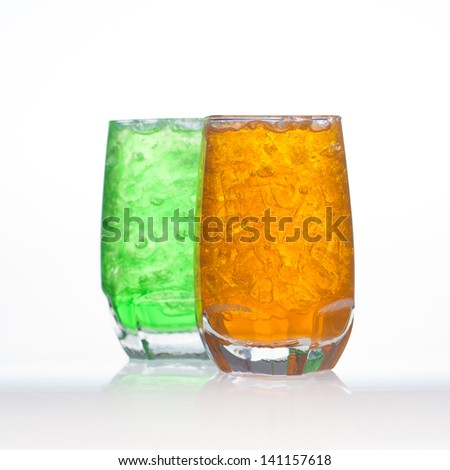 Orange flavor aerated soft drinks whit soda and ice in glass isolated - stock photo