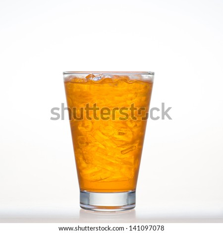 Orange flavor drinks whit sparkling soda and ice in glass isolated on white background - stock photo