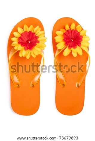 orange flip-flops with flowers on a white background - stock photo